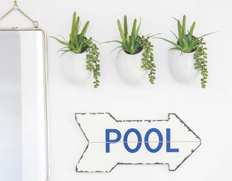 Mirror greenery and pool sign detailing home page