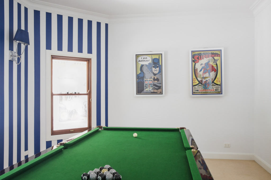 batman and superman framed comics with pool table and balls