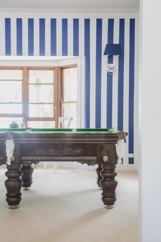 blue and white painted wall stripes and pool table