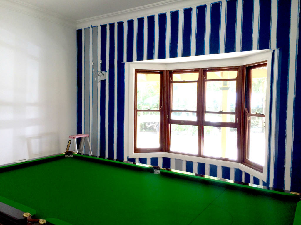 pool room wall taped up with grey undercoat