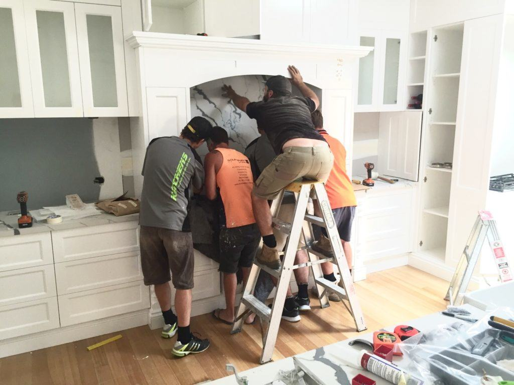 installing the stone splash back in kitchen