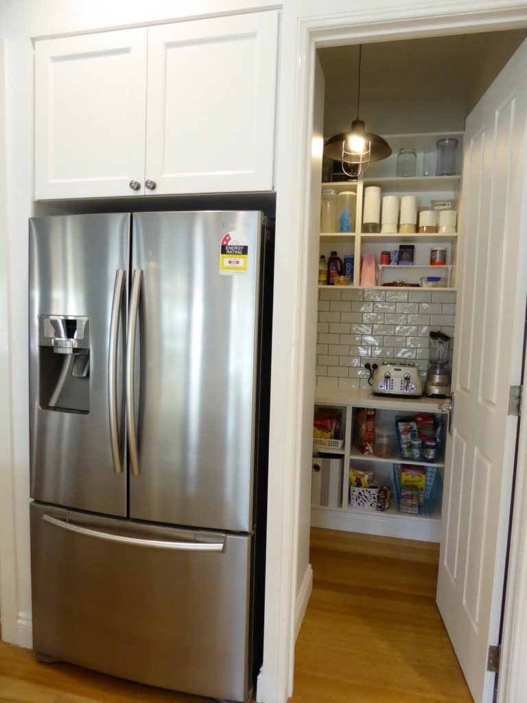 new placements of the fridge and pantry in kitchen