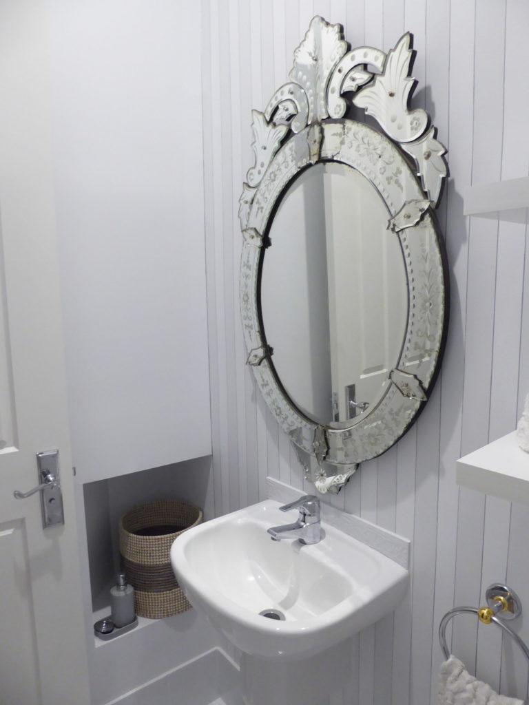 kids toilet mirror, nook and basket detail after renovation