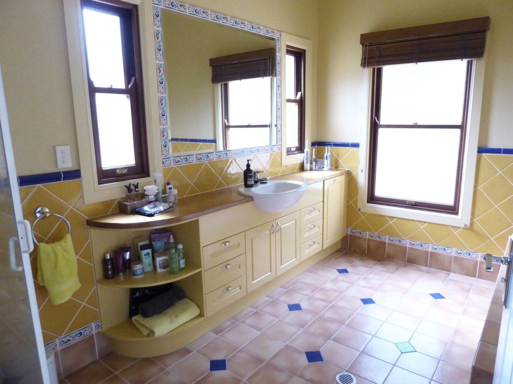 Original kids bathroom cabinetry and mirror