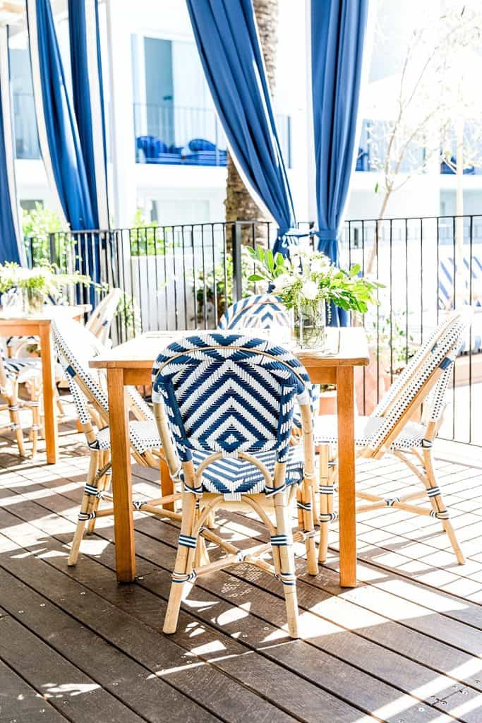 halcyon house outdoor bistro setting and blue curtain