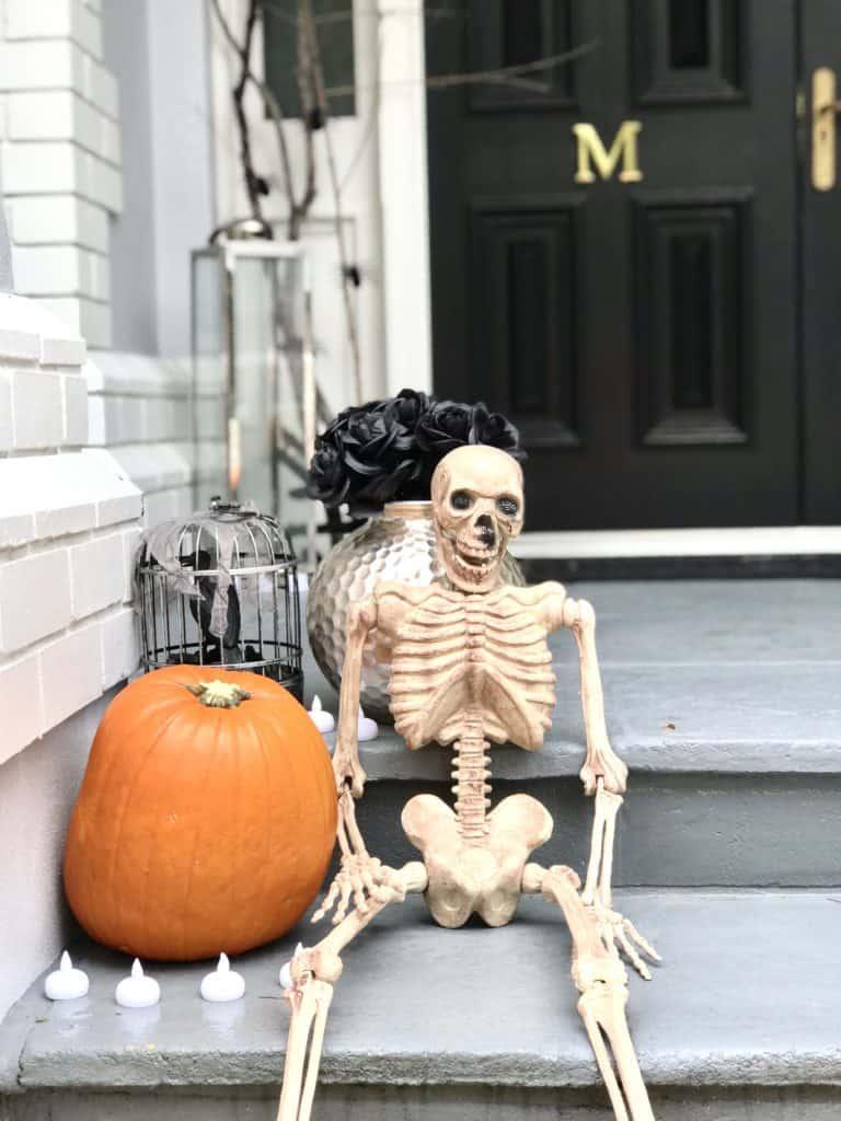 halloween styling - skeleton, pumpkim, flowers and crow display