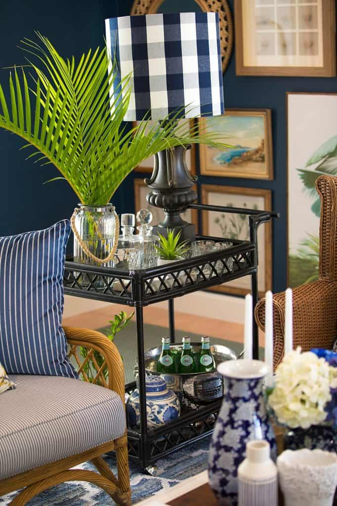 Tanawha formal lounge after renovation - bar cart, checked lamp and palm fronds